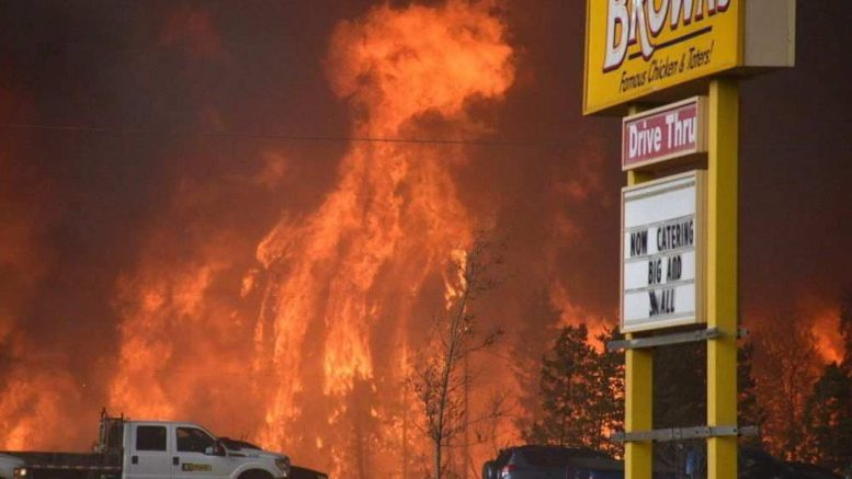 a-wall-of-fire-rages-outside-of-fort-mcmurray-alta-tuesday-777x437
